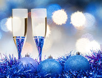 Glasses, blue Xmass balls on blurry background 8 Royalty Free Stock Photography