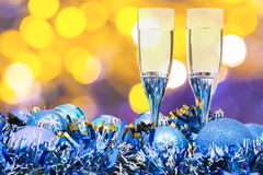 Glasses, blue Xmass balls on blurry background 1 Royalty Free Stock Image