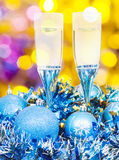 Glasses, blue Xmass balls on blurry background 5 Royalty Free Stock Images