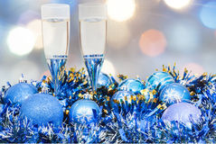 Glasses, blue Xmass balls on blurry background 6 Royalty Free Stock Photos
