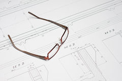 Glasses on the blueprint Stock Photography