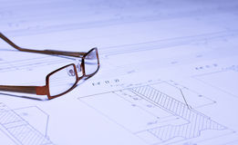 Glasses on the blueprint Royalty Free Stock Images