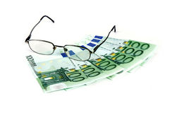 Glasses with bonds of euro royalty free stock photo