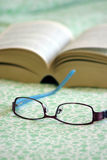 Glasses and book Stock Image