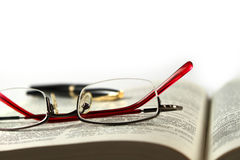 Glasses on the book Stock Images