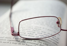 Glasses on a book Stock Image