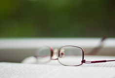 Glasses on a book Royalty Free Stock Photo