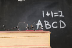 Glasses on book Royalty Free Stock Photos
