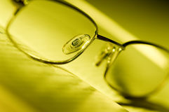 Glasses on a book Stock Photography