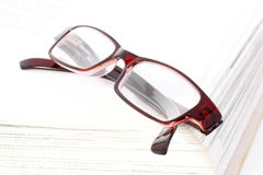 Glasses on the book. Compound glasses on an open book Royalty Free Stock Photos