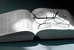 Glasses in a book Royalty Free Stock Images