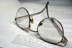 Glasses and a book Royalty Free Stock Photos