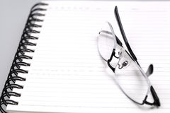 Glasses on the book. Macro shoting Royalty Free Stock Photo