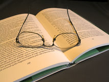 Glasses on book. Reading glases on open book royalty free stock photo