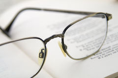 Glasses on the book. Stock Photography