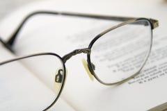 Glasses on the book. Macro shoting Stock Photography
