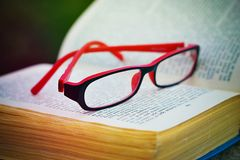 Glasses on a book Royalty Free Stock Photos