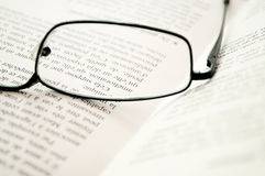 Glasses on a book Stock Photos
