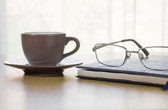 Glasses and book on the desk Stock Image