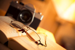 Glasses, book and film camera Royalty Free Stock Photos