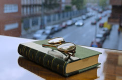 Glasses on the Book. Front of the window Stock Image
