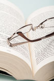 Glasses on book Stock Images