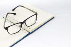 Glasses and book isolated. On white background Stock Photo