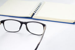 Glasses and book Stock Images