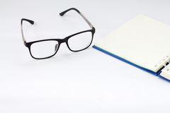Glasses and book. Isolated on white background Stock Photo