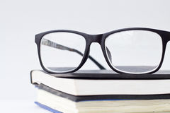 Glasses and book. Isolated on white background Stock Photography