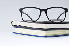 Glasses and book Stock Photos