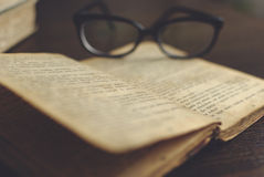 Glasses on a book. Glasses on a old book royalty free stock images