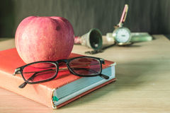 Glasses on the book. Stock Photo