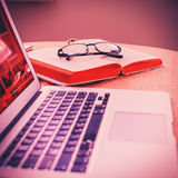 Glasses , book and open laptop Royalty Free Stock Image
