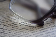 Glasses on a book page Stock Image