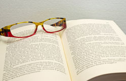 Glasses on book. A pair of glasses on some books Stock Photo