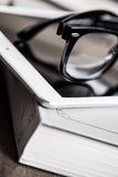 Glasses and a book Royalty Free Stock Images