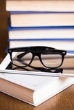 Glasses and a book Stock Photos