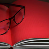 Glasses and book. With red pages, fill text field Stock Photo