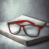 Glasses on book Stock Photo