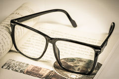 Glasses and book. Vintage tone Royalty Free Stock Images