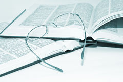Glasses on a books Stock Images