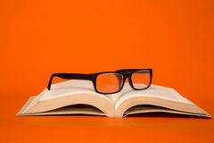 Glasses on books. Glasses on blind student books Royalty Free Stock Photo