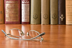 Glasses and books in library Royalty Free Stock Photos