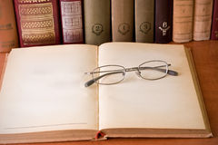 Glasses and books in library Royalty Free Stock Images