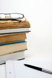 Glasses,books,pen and paper Stock Photography