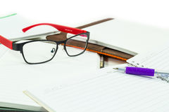 Glasses on books Royalty Free Stock Photos