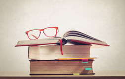 Glasses on books with pencil Royalty Free Stock Photo