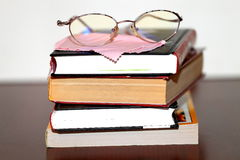 Glasses and books after reading Royalty Free Stock Photo