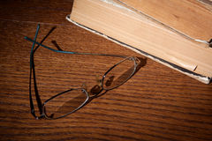 Glasses and books Stock Photos